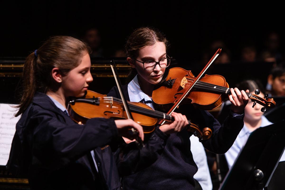 King David students playing violin